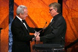 Honoree Lorne Michaels accepts his award from Nichols.