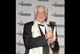 Director Bertrand Tavernier holds up his cystal eagle for the press cameras. (Photo by Peter Kramer/Getty Images)