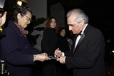 Martin Scorsese delights a fan with an autograph.