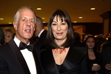 DGA President Apted with presenter Anjelica Huston.