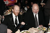 Two-time feature Award winner Ron Howard and three-time nominee Rob Reiner share a dinner table.