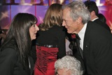 Presenter Anjelica Huston congratulates Clint Eastwood.