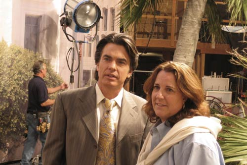 Lisa Cochran on The O.C. with cast member Peter Gallagher.