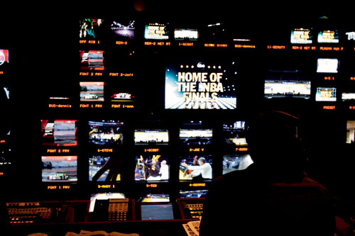 BALL CONTROL: The director calls the shots from the control room during the game. - Photo by Wendi Kaminski